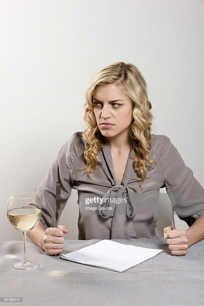 Woman waiting in restaurant : Stock Photo