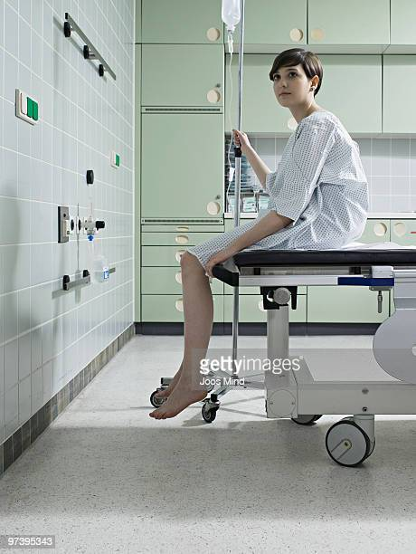 woman waiting on examination table in hospital