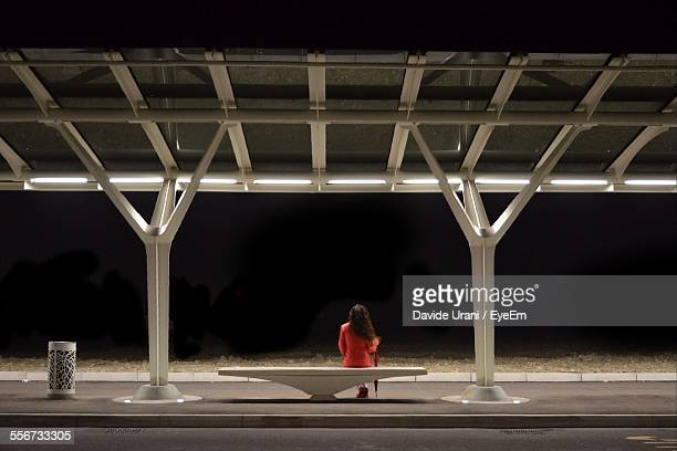 Woman Waiting On Railroad Station Platform