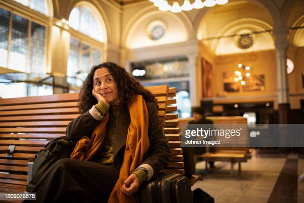 woman waiting on train station - railway station stock pictures, royalty-free photos & images