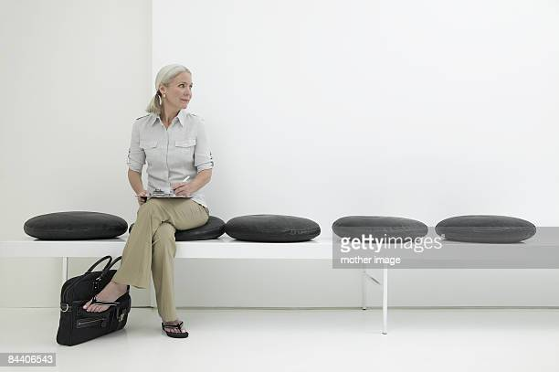 woman waiting - waiting room stock pictures, royalty-free photos & images