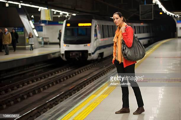 Woman waiting subway
