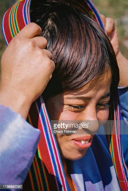 Woman waiting to be blessed by Buddhist Bhutanese spiritual leader Trulku Jigme Chode as he makes his way from the capital city Thimphu to his winter...