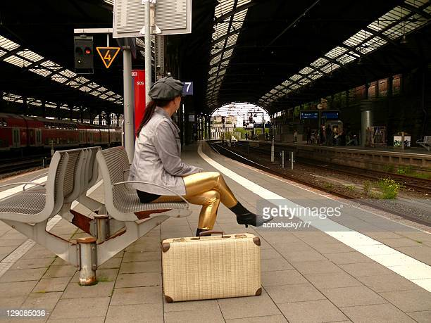 woman waiting train - gold pants stock photos and pictures