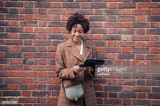 Woman waiting with a mobile phone
