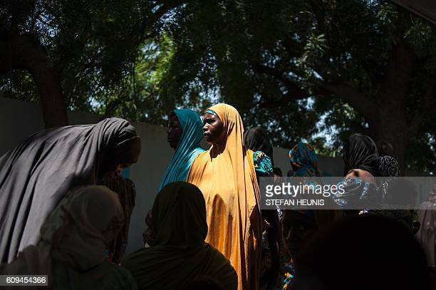 TOPSHOT A woman waits at a public health facility in the Dalaram district in Maiduguri the capital of Borno State northeastern Nigeria on September...