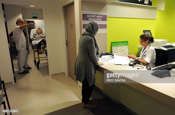 A woman waits at the reception in the Belharra clinic owned by the Swedish Group Capio on August 20 2015 in Bayonne AFP PHOTO / GAIZKA IROZ