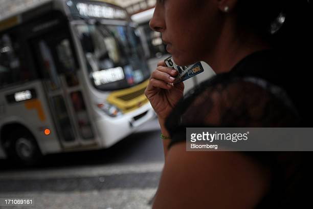 A woman waits for a bus on the Presidente Getulio Vargas Avenue in Rio de Janeiro Brazil on Friday June 21 2013 Brazils swelling street rebellion...