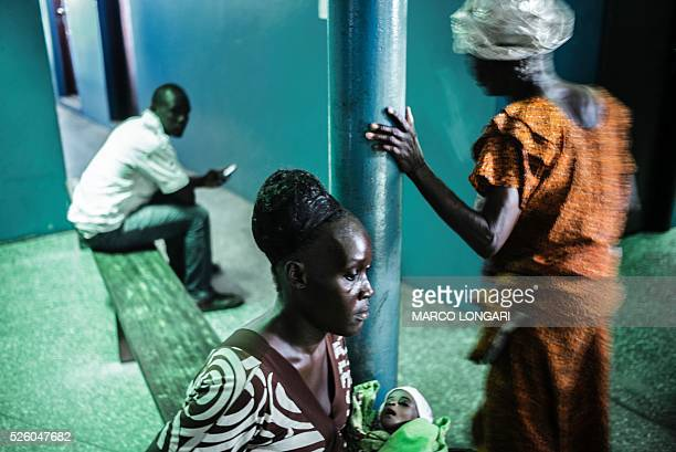 A woman waits for a consultation at the Star of the Sun Health Centre in the Monrovia township of West Point on April 29 2016 Young mothers in the...