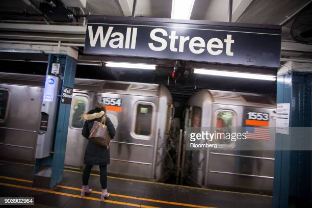A woman waits for a train at a Wall Street subway station near the New York Stock Exchange in New York US on Thursday Jan 11 2018 US stocks rebounded...