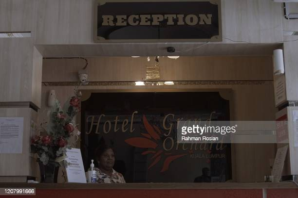 A woman waits for customers at the front desk of a local hotel on March 23 2020 in Kuala Lumpur Malaysia Prime Minister Tan Sri Muhyiddin Yassin said...