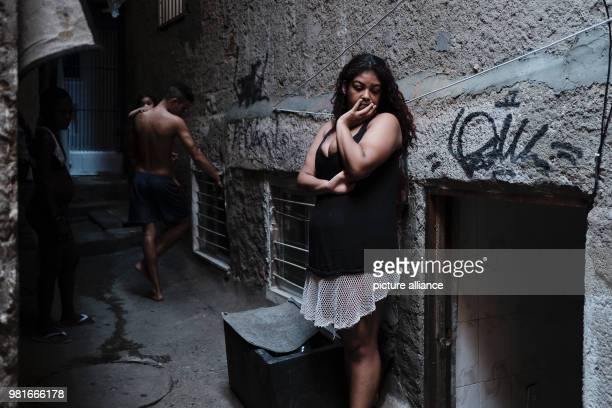 A woman waits for help to repair a wall in her house at the Rocinha favela in Rio de Janeiro Brazil 27 March 2018 Photo Diego Herculano/dpa