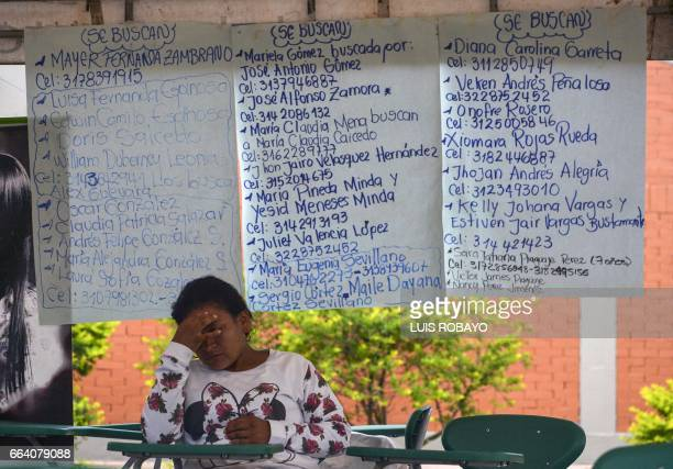 A woman waits for news of her missing relatives at a shelter in Mocoa Putumayo department southern Colombia on April 3 2017 Residents of Mocoa were...