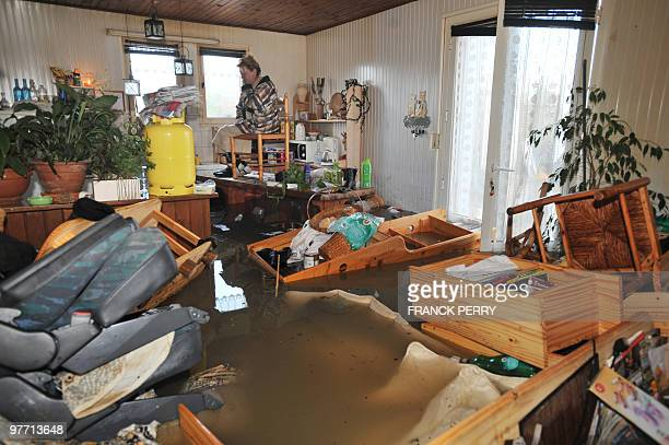 A woman waits for rescuers in her kitchen on February 28 as a result of heavy floods in La FautesurMer western France Dubbed 'Xynthia' the Atlantic...