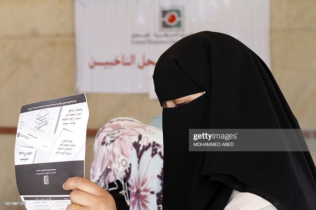 A woman waits her turn as electoral commission officials register Palestinians at a registration tent set-up along a street in Gaza City on February 20, 2013. Palestinian electoral officials are updating voter rolls in the West Bank and Gaza in a vital step towards eventual elections.