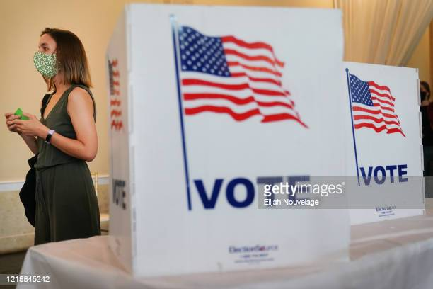 A woman waits in line to vote in Georgia's Primary Election on June 9 2020 in Atlanta Georgia Voters in Georgia West Virginia South Carolina North...