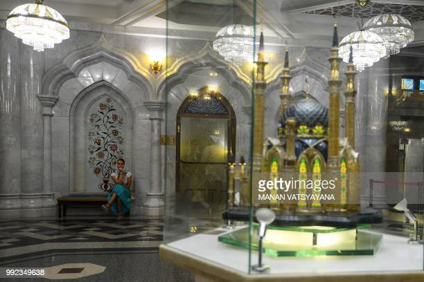 A woman waits inside the Qolsharif mosque in Kazan on July 5 on the eve of the Russia 2018 World Cup quarter final football match between Belgium and...