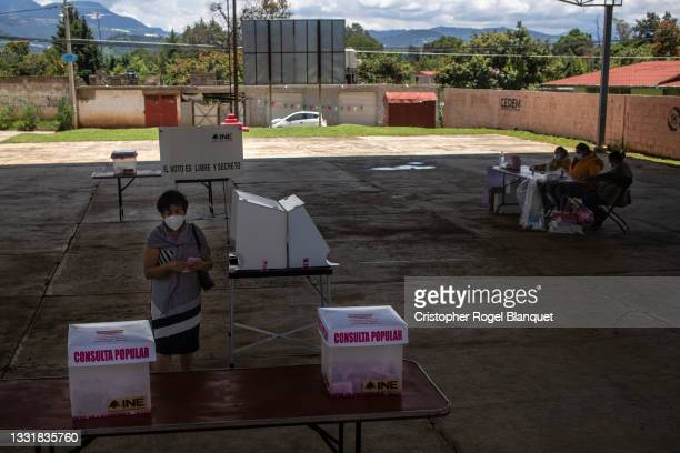 Woman waits to cast her vote during the first referendum to put five former presidents to trial on August 1, 2021 in Tpetzingo, Mexico. In a proposal...