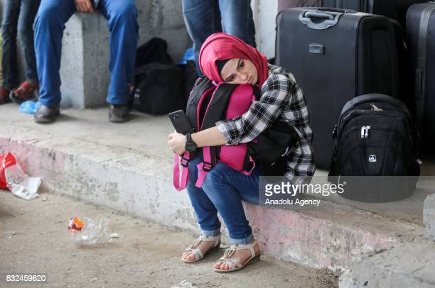 A woman waits to cross the Rafah Border with his luggages in Rafah Gaza on August 16 2017 Egypt decided to open Rafah Border Gate for only 2 days...