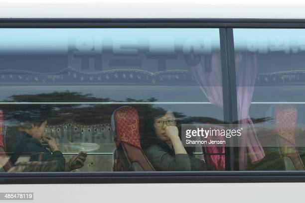 A woman waits to go to Jindo Island by bus from Danwon High School on April 18 2014 in Ansan South Korea 325 students and 15 teachers of Danwon High...
