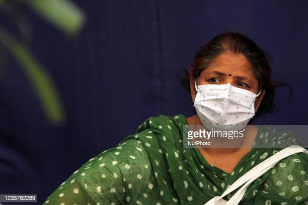 Woman waits to receive a dose of the COVID-19 vaccine in New Delhi, India on July 3, 2021. India became the third country after the United States and...
