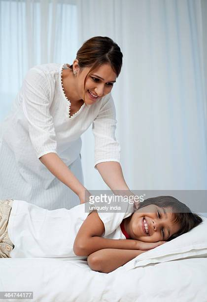 Woman waking up her son