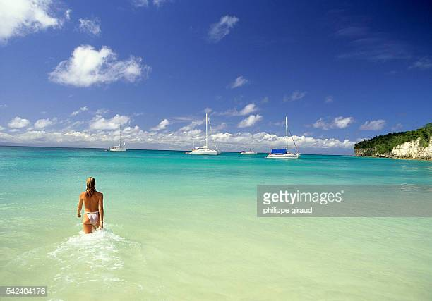 Woman walk in the sea at the beach of Vieux Fort on the island of Marie Galante | Location Marie Galante Guadeloupe