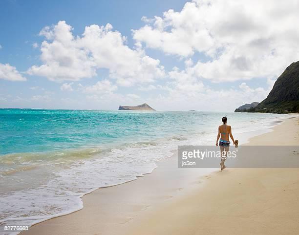Woman walk on the beach, near view