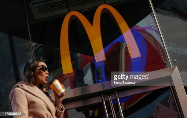 A woman walk pass McDonald's restaurant in Times Square following the firing of their CEO Steve Easterbrook on November 4 2019 in New York City...