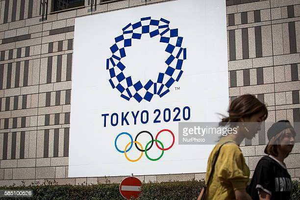 A woman walk past at the Tokyo Olympic Games logo at Tokyo Metropolitan Government Office building at Shinjuku Tokyo Japan on Sunday morning July 31...
