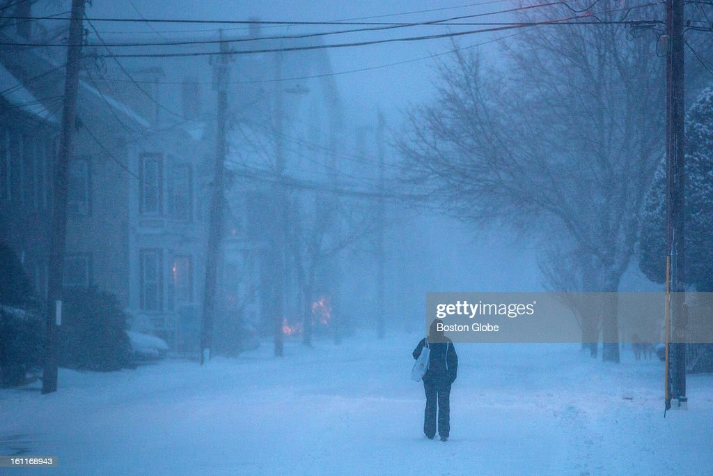 A woman walked along Washington Street as a winter storm, expected to dump as much as 24 inches of snow in the region, intensified in Newburyport.