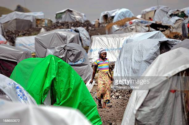 A woman walkes to her tent in camp Mugunga III for displaced persons on January 14 2013 in Goma Democratic Republic of Congo The war in Congo which...