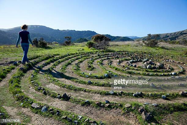 woman walking a labyrinth - maze stock photos and pictures