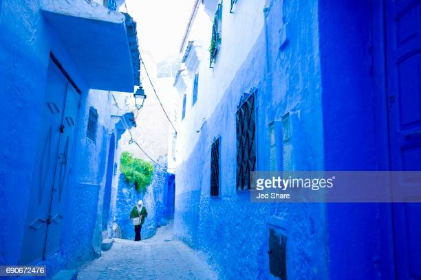 Woman Walking A Street in Northern Morocco