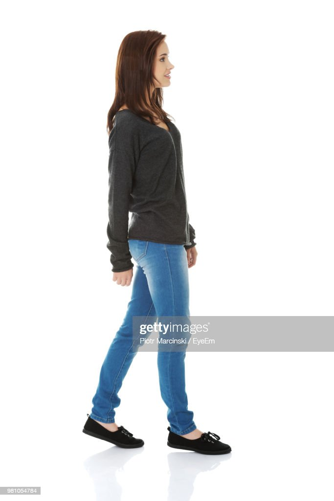 Woman Walking Against White Background : Stock-Foto