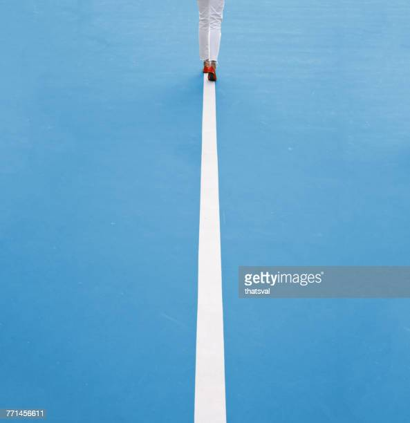 Woman walking along a straight line