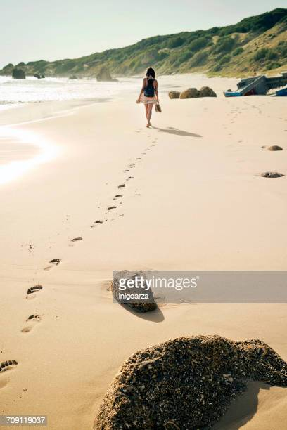 Woman walking along Bolonia Beach, Tarifa, Cadiz, Andalucia, Spain