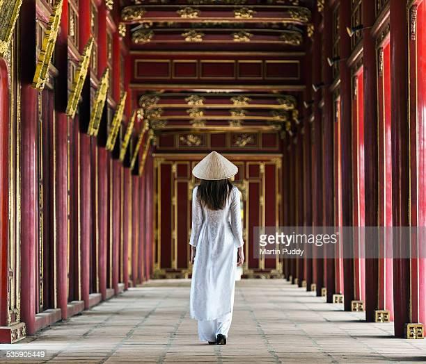 Woman walking along corridor