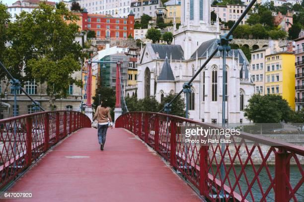 woman walking along footbridge - lyon stock pictures, royalty-free photos & images