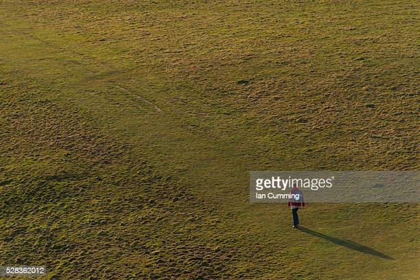 woman walking along south west coast path near golden cap on the jurassic coast; seatown, dorset, england - wide stock pictures, royalty-free photos & images