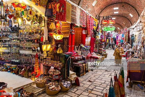 woman walking along vaulted street in medina - sousse stock pictures, royalty-free photos & images