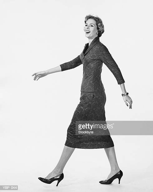 Woman walking and smiling