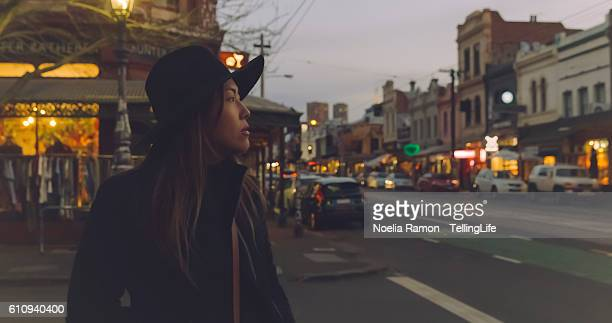 a woman walking around fitzroy, melbourne. - melbourne australia stock pictures, royalty-free photos & images