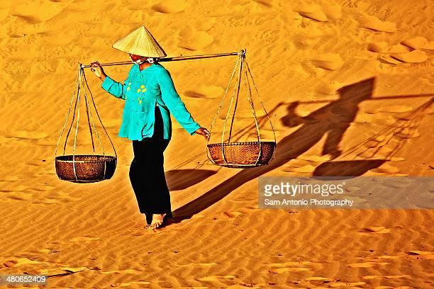 Woman Walking at Red Sand Dunes in Mui Ne, Vietnam
