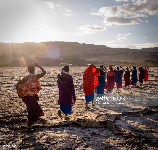 woman walking at salt lake during sunset - east africa stock pictures, royalty-free photos & images