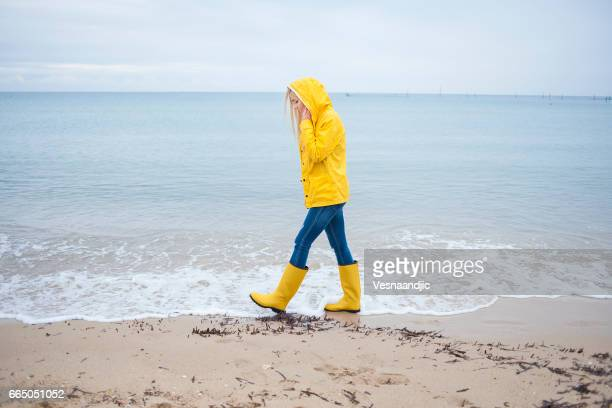 woman walking at the beach - white boot stock pictures, royalty-free photos & images