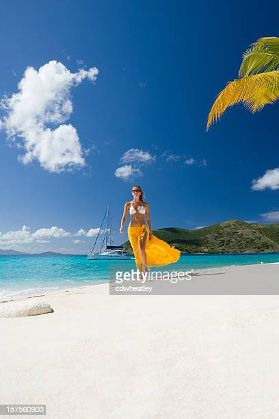 woman walking at the caribbean beach - catamaran stock photos and pictures