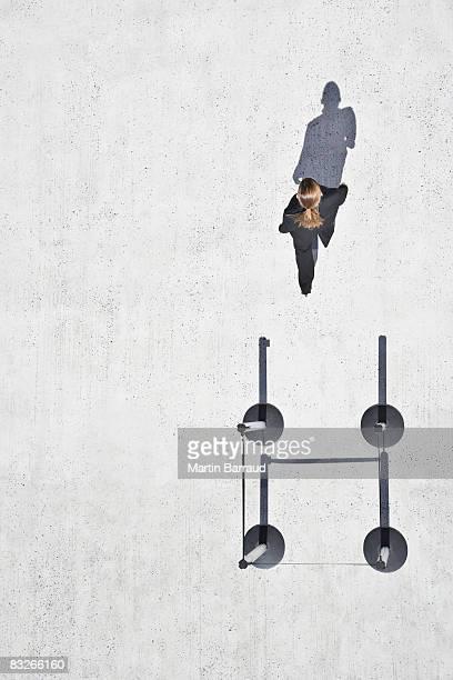 Woman walking away from cordon posts