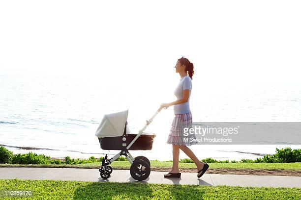 Woman walking baby stroller