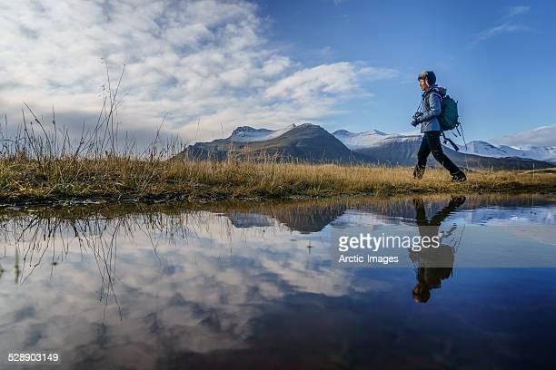 Woman walking by a lake, Iceland